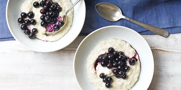 Two bowls of healthy porridge topped with blueberry compote