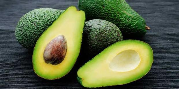 An avocado cut in half on a table