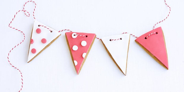 Bunting shaped biscuits in white and pink patterns