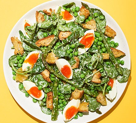Roasted asparagus, pea & egg salad served on a plate