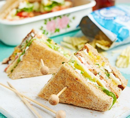 Triangular egg and cress sandwiches on sticks