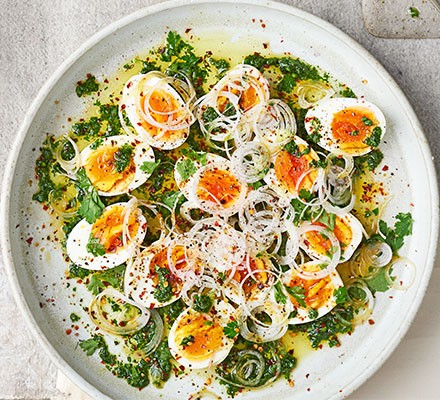 Egg & parsley salad with watercress dressing served in a white bowl