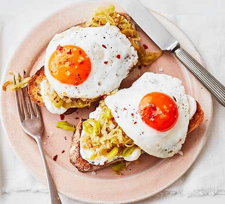 A plate serving chilli & garlic leeks with eggs on toast