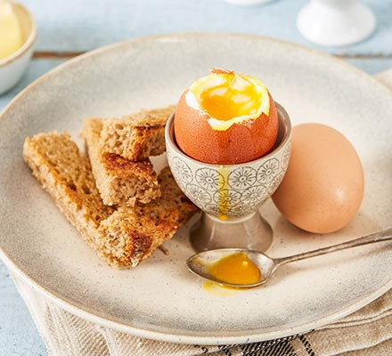 Soft boiled eggs served with soldiers