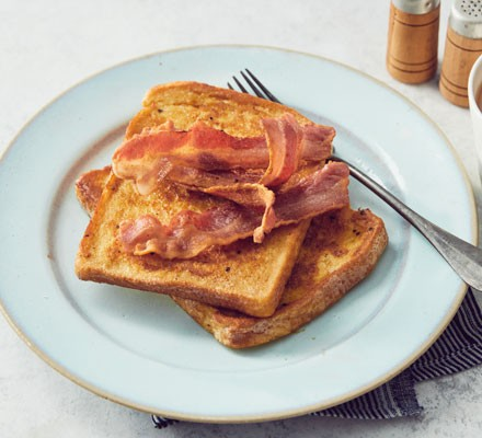 Eggy bread with bacon on plate