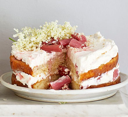 Rhubarb & elderflower cake served garnished with elderflowers on top