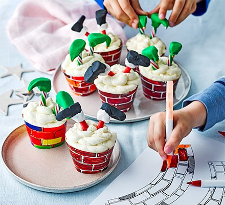 A selection of elf & santa cupcakes served on two plates