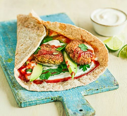 Falafel in a wrap with vegetables and hummus