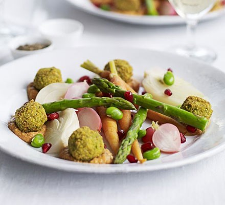 Falafels with spicy tomato & cashew sauce & poached spring vegetables