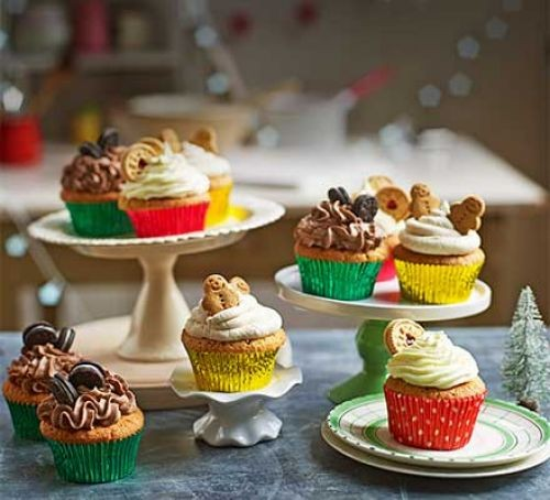 Christmas cupcakes topped with buttercream and biscuits