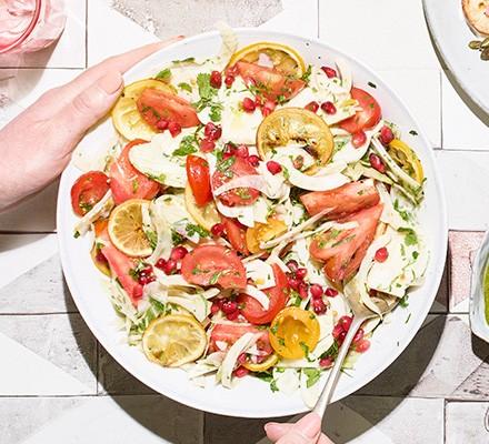 Fennel, roast lemon & tomato salad served on a plate