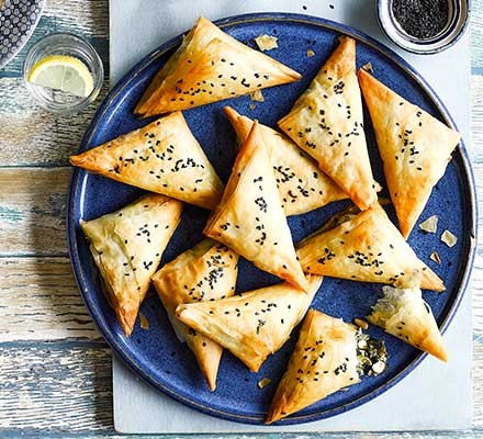 Feta, date & spinach pastries served on plates
