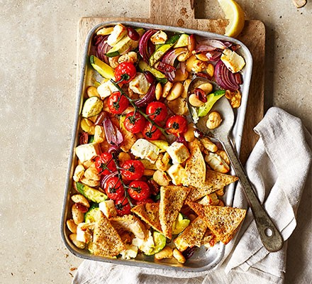 Greek feta traybake served in a roasting dish