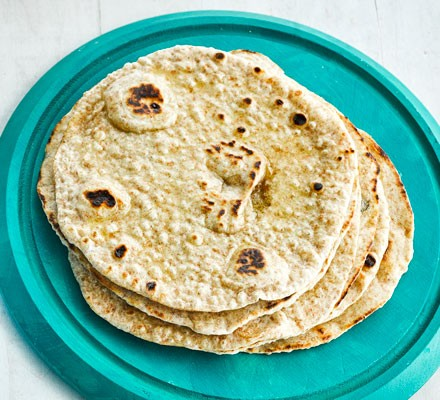 Flatbreads in stack on plate