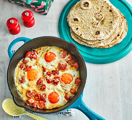 Flatbreads with brunch-style eggs served in a frying pan