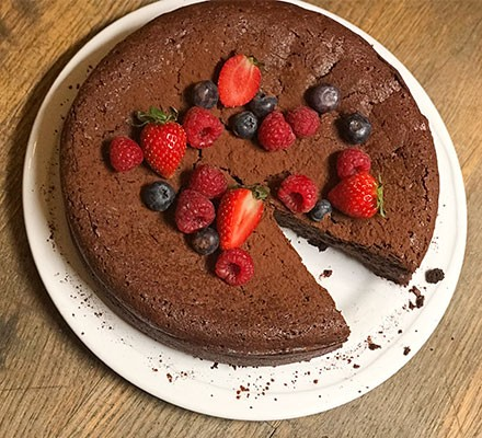 Flourless chocolate cake served on a plate