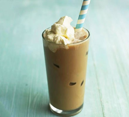 Coffee frappé with cream and straw