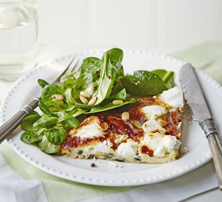 Slice of frittata with nutty green salad & balsamic dressing