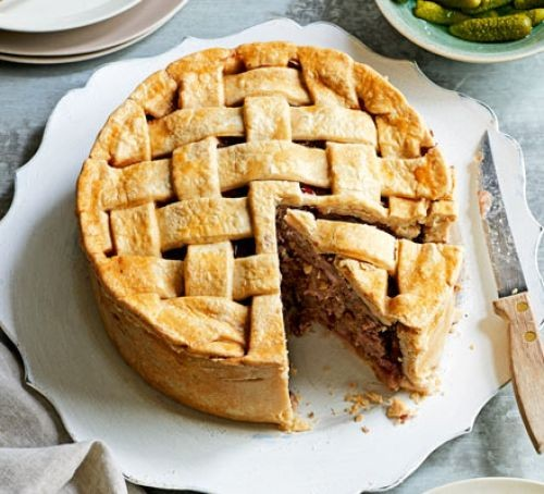 Game pie with pastry lattice on a plate