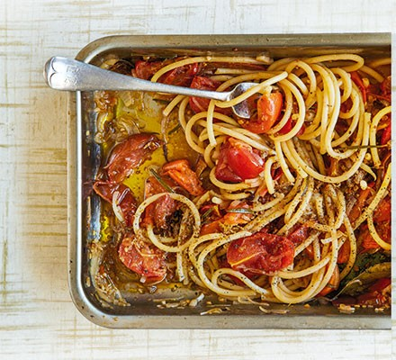Roast tomato pasta in a dish with fork
