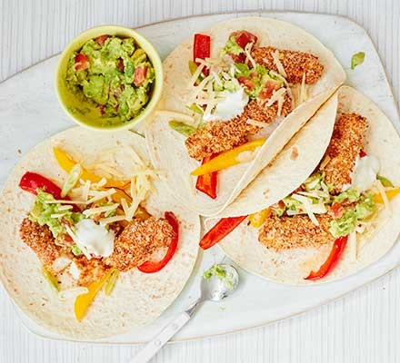 3 tortillas with breaded haddock and salad
