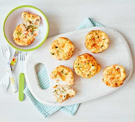 A serving board with 5 mini egg & veg muffins