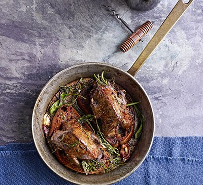 Pigeon breasts in pot with herbs
