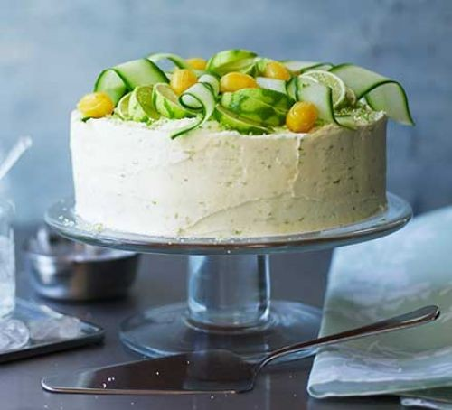 Gin and toni cake topped with limes and cucumber