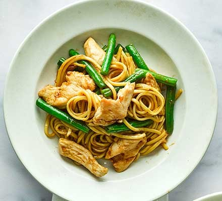 Ginger chicken & green bean noodles served on a plate