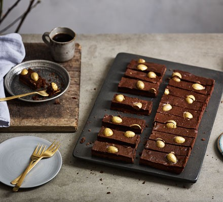 Chocolate traybake topped with golden eggs