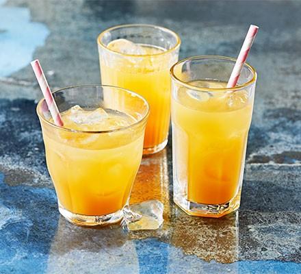 Three glasses of golden pineapple & vanilla iced tea