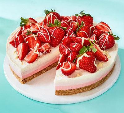 layered cheesecake with strawberries on top
