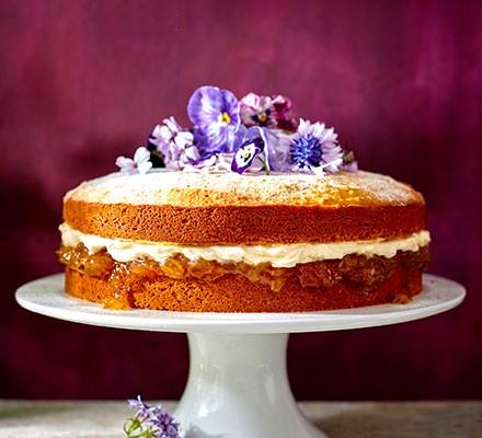 Gooseberry jam, muscat & mascarpone cake on a cake stand