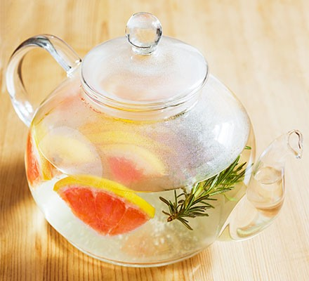 Green tea with grapefruit and rosemary served in a teapot