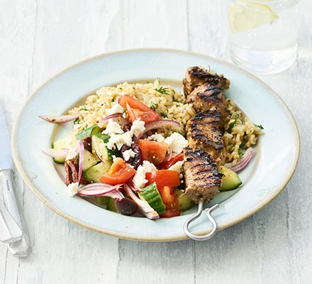 Pork souvlaki with Greek salad & rice served in a bowl