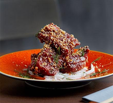 A red plate serving grilled Saigon pork rib