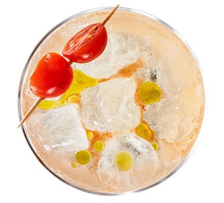 A glass serving Mediterranean savoury G&T