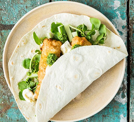 A battered fish & pesto wrap served on a plate