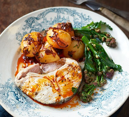 Hake with paprika oil potatoes served on a plate