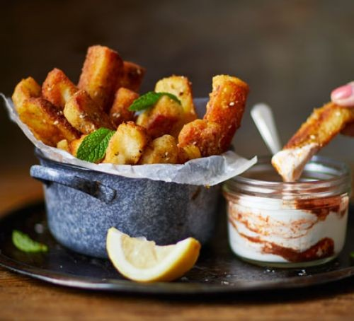Halloumi cheese fries in a pot with sauce