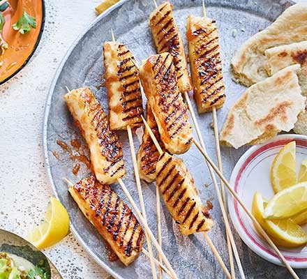 Membrillo-glazed halloumi skewers served on a plate