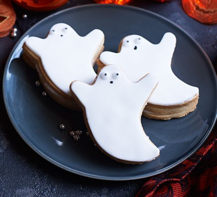 A plate serving Halloween piñata biscuits