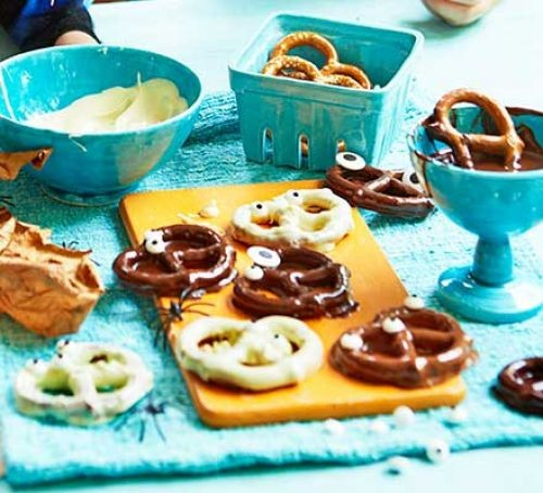 Chocolate covered pretzels with edible eyes