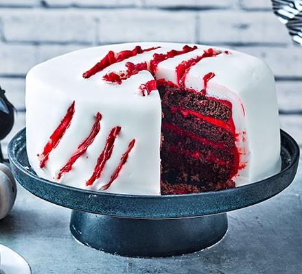 Halloween slash cake served on a cake stand