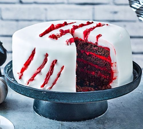 Halloween cake with white icing and red slash pattern