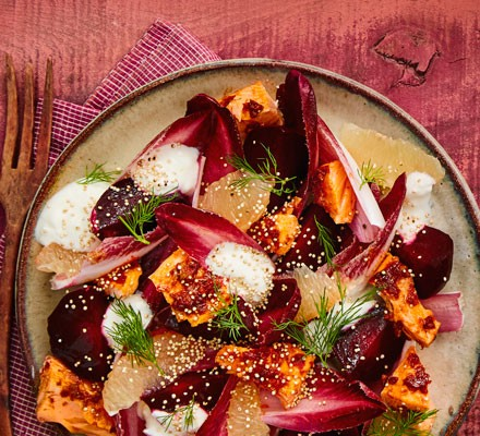 Salad with trout, grapefruit, beetroot and feta on plate