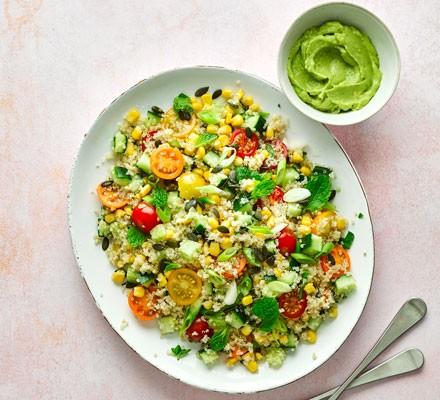 A dish of quinoa salad with avocado mayo