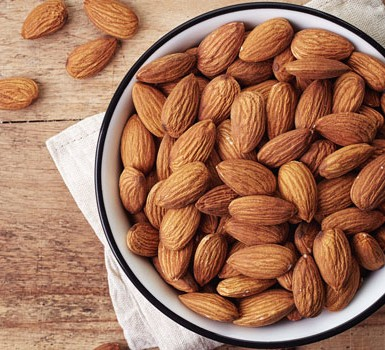 A bowl of almonds on a table