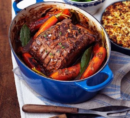 Pot-roast beef with French onion gravy in a cooking dish