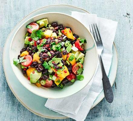 A bowl of mango, avocado and black bean salad